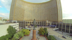 Frontal view of Hotel Cosmos with statue of Charles de Gaulle Stock Footage