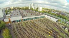Front view of subway depot during the day at the edge of city - stock footage