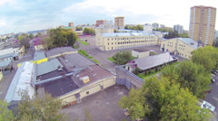 Military compound with multiple buildings and city, aerial view Stock Footage