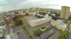 Army garrison with big plateau in front of barracks, aerial view Stock Footage