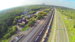 House complex near train lines during the day Stock Footage