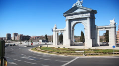 Driving around Arch Puerta de San Vicente in Madrid Stock Footage
