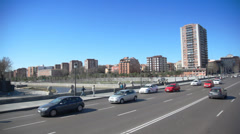 Going by car on bridge over river during the day Stock Footage