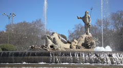 Monument to Poseidon riding his chariot on a fountain at day Stock Footage