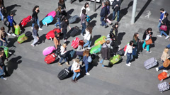 Lots of tourists with luggages walking on the street Stock Footage
