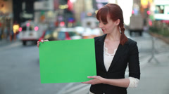 Caucasian business woman in New York City street holding message board - stock footage