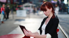Caucasian business woman in New York City street using ipad tablet Stock Footage