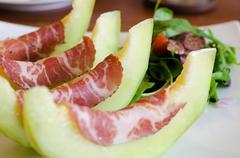 Italian appetizer, ham with melon Stock Photos