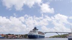 Curacao, Caribbean Sea, cruise ship docked under the bridge Stock Footage