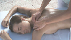 Young woman receiving back massage - stock footage