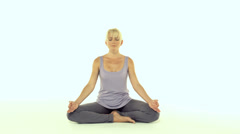 Young woman exercising yoga Stock Footage