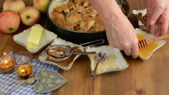 Apple pie baking. Sprinkled honey on the raw apple pie. Stock Footage