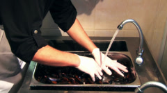 Cleaning mussels Stock Footage