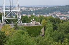 Roofs of city Lviv and television tower with trees - stock photo