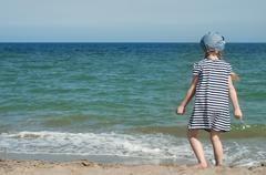 Girl and the sea - stock photo