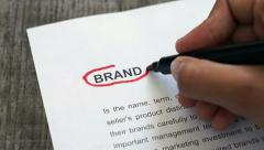 Circling brand with a red marker - stock footage