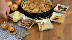 Apple pie baking. Sprinkled butter flakes on the raw apple pie. Stock Footage