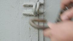Locking padlock on metal gates - stock footage