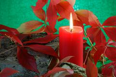 Autumn candle Stock Photos