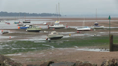 Boats at low tide on the river exe in exmouth Stock Footage