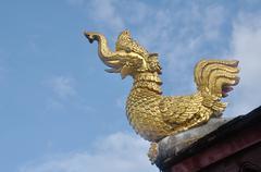 Mythical bird on the temple roof. Stock Photos
