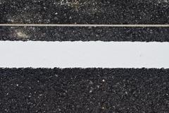View of asphalt with distinct white stripes. Stock Photos