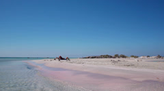 Holiday at the famous pink sand of Elafonisi beach Stock Footage