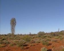 Vehicle shot red desert along Stuart Highway, Central Australia Stock Footage