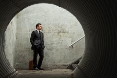 patience is a virtue… businessman waiting for something or someone - stock photo