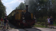 Stock Video Footage of Historical steam train rides towards railway crossing - on camera
