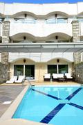 swimming pool by villa at the luxury hotel, halkidiki, greece - stock photo