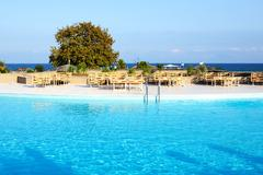 swimming pool near beach at the luxury hotel, halkidiki, greece - stock photo