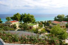view on beach and villas at the modern luxury hotel, halkidiki, greece - stock photo