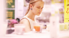 Young woman smelling scented candles Stock Footage