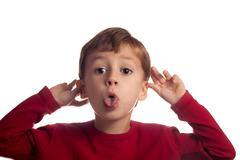 little boy goofing around - stock photo
