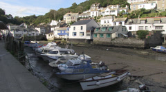 polperro harbour and boats at low tide Stock Footage