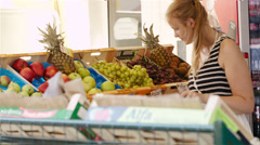 Young woman shopping for fresh fruit Stock Footage