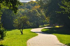 Misterious shady green alley with trees in the park in fulda, hessen, germany Stock Photos