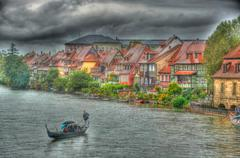 Regnitz river (hdr) with beautiful houses and a boat in bamberg, bayern (bava Stock Photos