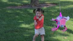 Toddler Girl and Pinata Stock Footage