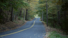Rural road during New England foliage season Stock Footage