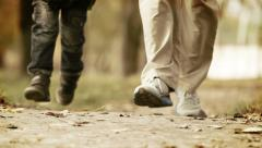 Father with little son jogging in the park Stock Footage