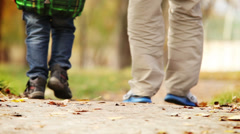 Heartiness words to dear daddy during walk in autumn park Stock Footage