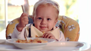 Stock Video Footage of funny baby eating pasta