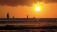 Stock Video Footage of Surfers & boats watching sunset on the ocean water waikiki 1