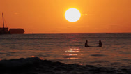 Stock Video Footage of Surfers & boats watching sunset on the ocean water waikiki 2