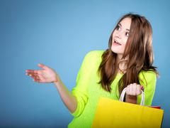 Surprised girl with paper shopping bag. sales. Stock Photos