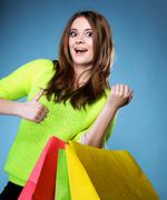 happy girl with paper shopping bag. sales. - stock photo