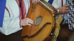 Ukrainian folk artist plays the bandura - stock footage