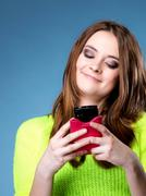 Happy girl with mobile phone reads message Stock Photos